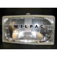 1235051 G koplamp H1 Volvo 260 R. -1979